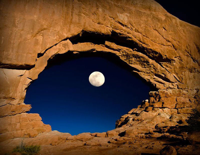 the-moon-through-north-window-arches-national-park-utah-united-states